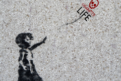 Banksy's Unwanted Life Logo