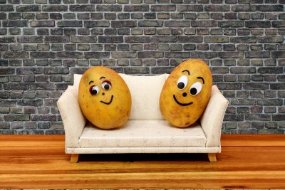 An image of two potatoes with drawn on faces sitting on a safe to represent my relationship with food