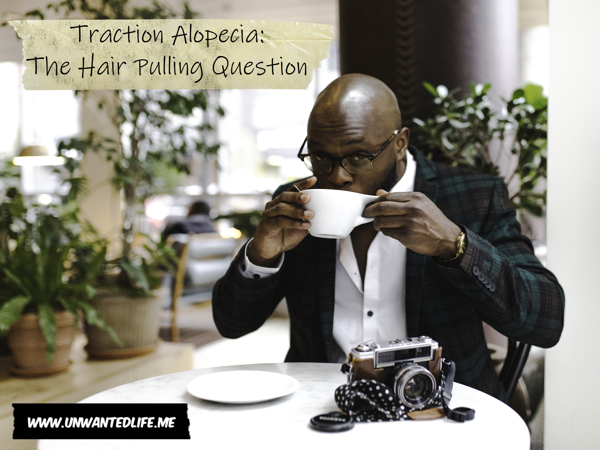 A photo of a bald black man drinking coffee to represent - Traction Alopecia: The Hair Pulling Question