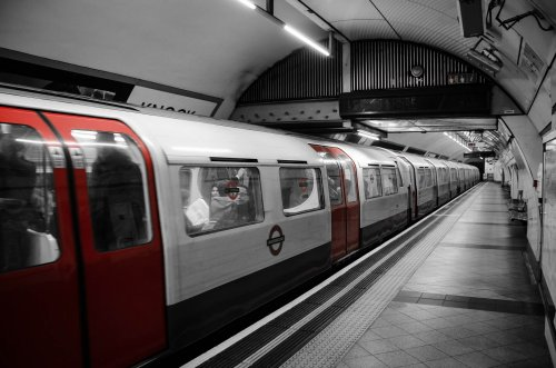 A photo of a moving London tube train to represent the topic of the article - Having A Freedom Pass When You Have An Invisible Disability