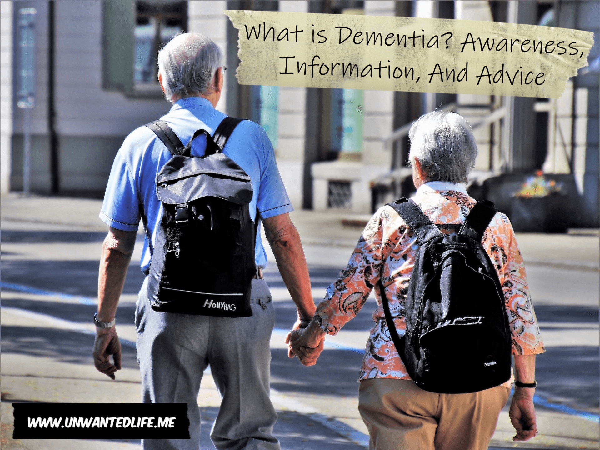 An old couple walking through a city holding hands with the title of the article - What is Dementia Awareness, Information, And Advice - in the top corner