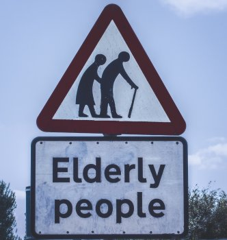 A photo of a road sign for elderly people crossing to refer to dementia