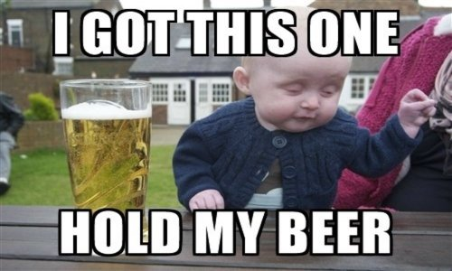 """A meme of a baby looking drunk next to a pint of beer to mock Boris Johnson as if he's saying """"hold my beer"""" before being racist"""