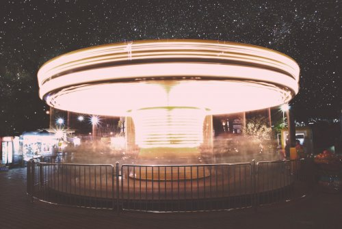 Merry go round at night to represent dizziness and balance to represent the article title - What Is Persistent Postural-Perceptual Dizziness (PPPD)?