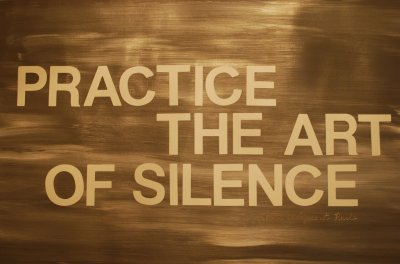 "The image had he words ""practice the art of silence"" wrote on a bronze coloured background to represent the topic of the article - Sitting In Silence: Will It Transform Your Life?"