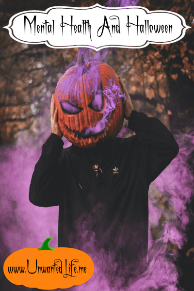 A photo of a person wearing a pumpkin on their head with purple smoke coming our of it to represent the topic of the article - Mental Health And Halloween