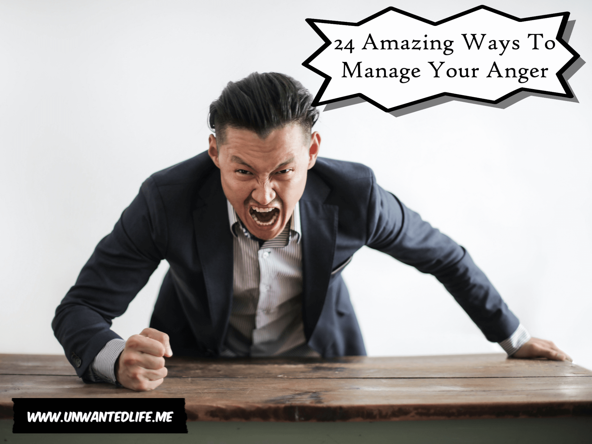 A photo of an Asian man screaming at the camera and hitting the desk to represent the topic of the article - 24 Ways To Manage Anger