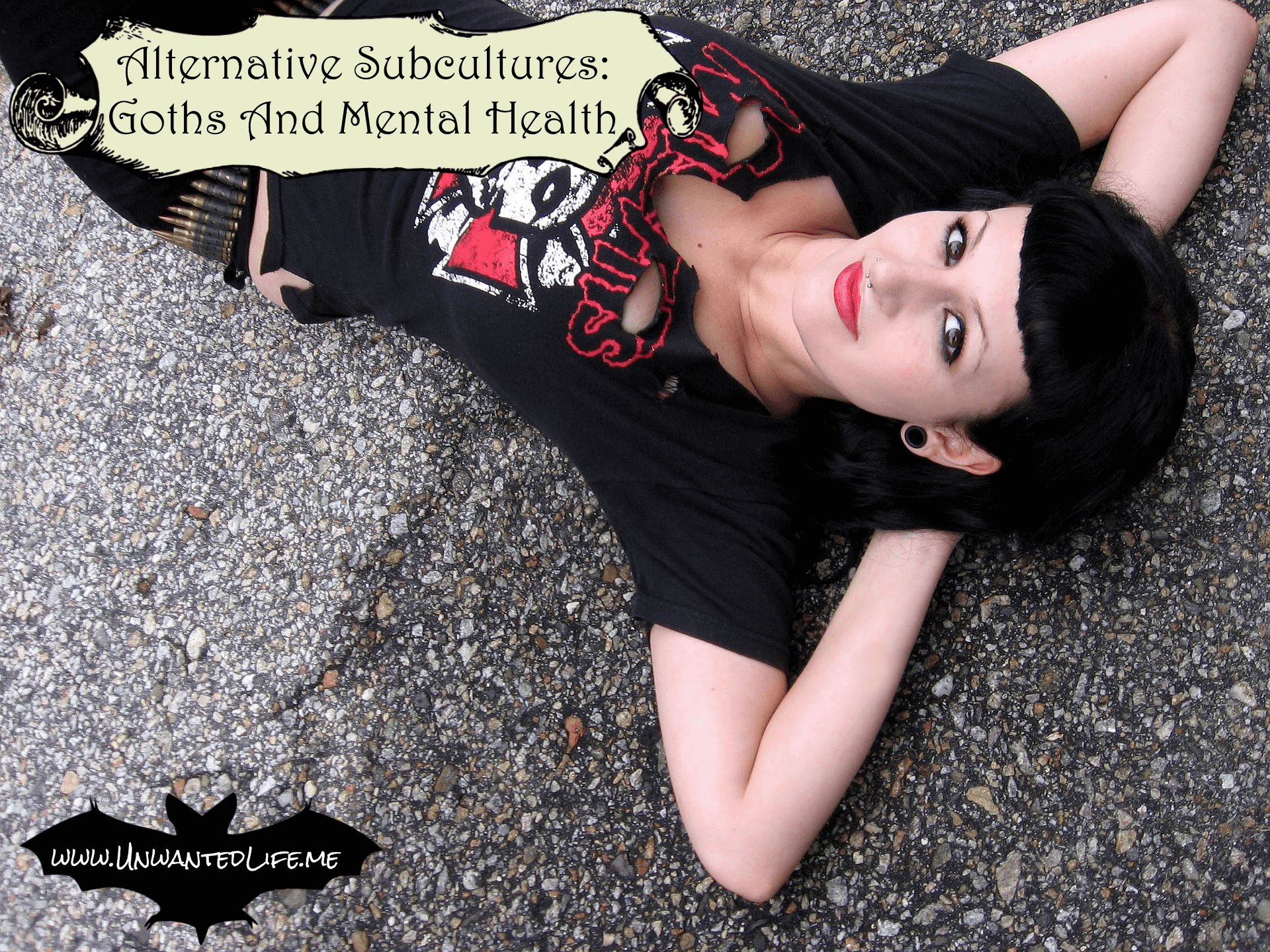 A photo of a female goth laying on a concreate ground outside to represent the topic of the article - Alternative Subcultures: Goths And Mental Health