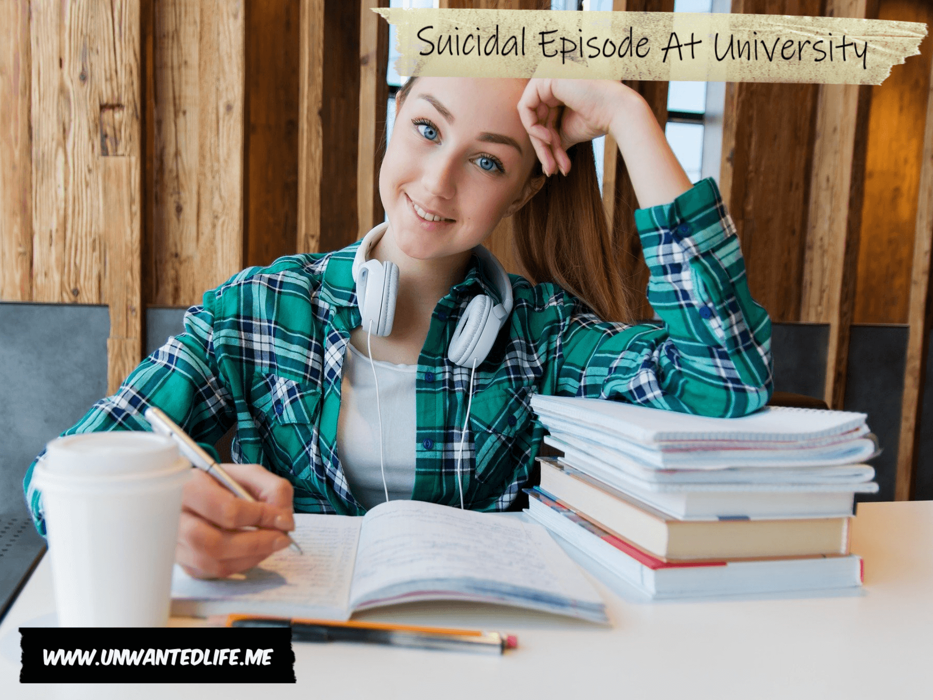 A white female university student sitting with a pile of books and writing in a notebook to represent the topic of the article - Suicidal Episode At University | Mental Health and Wellbeing