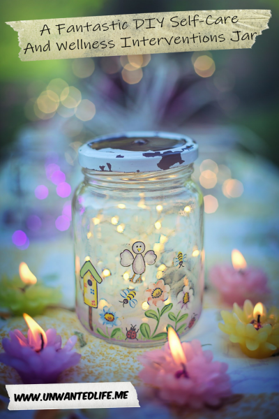 A photo of a decorated jar with lit flower shaped candles around it to represent - A Fantastic DIY Self-Care And Wellness Interventions Jar