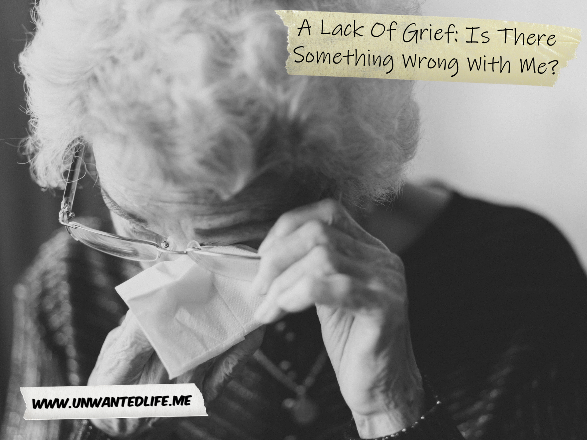 A black and white photo of an elderly white lady removing her glasses to wipe away tears with the article title - A Lack Of Grief: Is There Something Wrong With Me? - in the top right corner