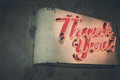 "A neon sign that says ""Thank You"" for reading my anniversary blog article"
