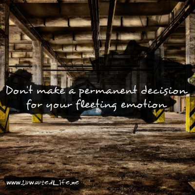 """An inspirational quote about mental health that says """"Don't make a permanent decision for your fleeting emotion"""". The quote is on a ink stain on top of an industrial background"""