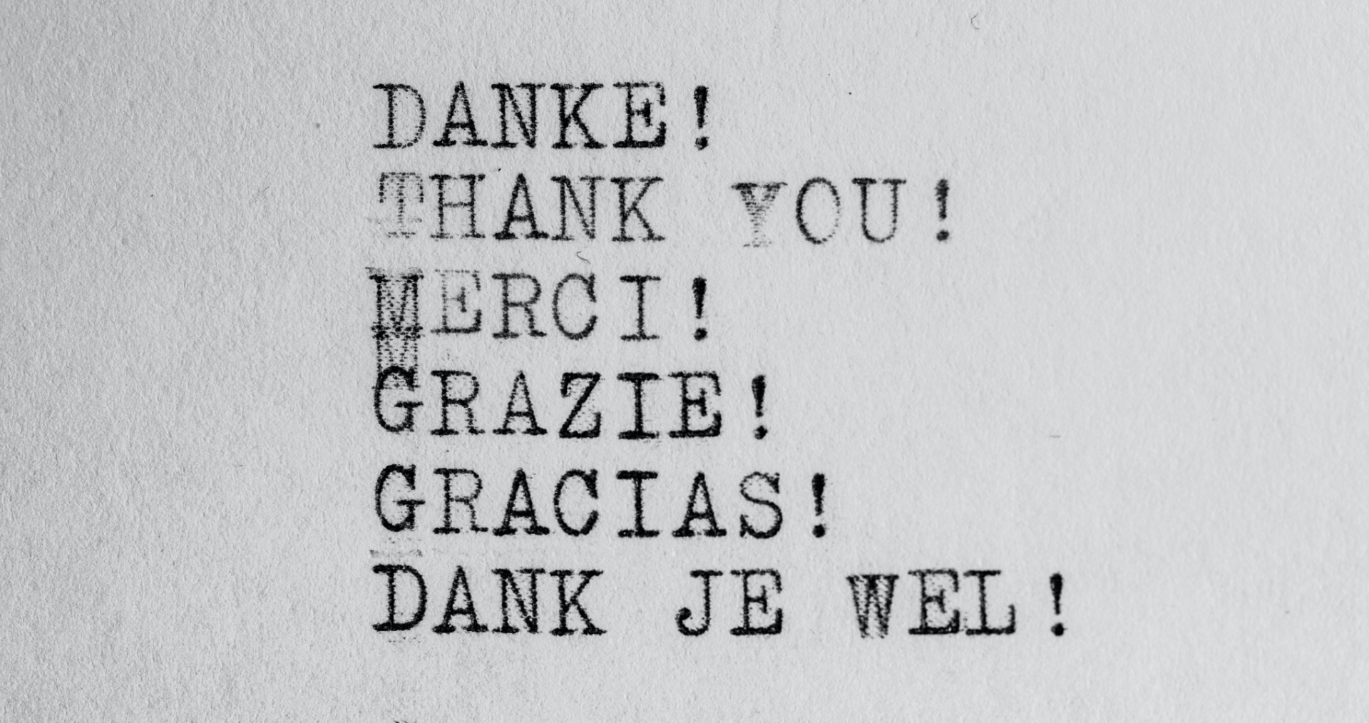 The image was created by using an old type writer to type out thank you in six different languages