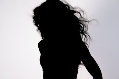 A female silhouette to represent the manager in the story that caused the broken mind
