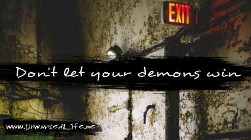 "The quote says ""Don't let your demons win"" wrote in white on a black ink mark over an image of the inside of an abandoned building"