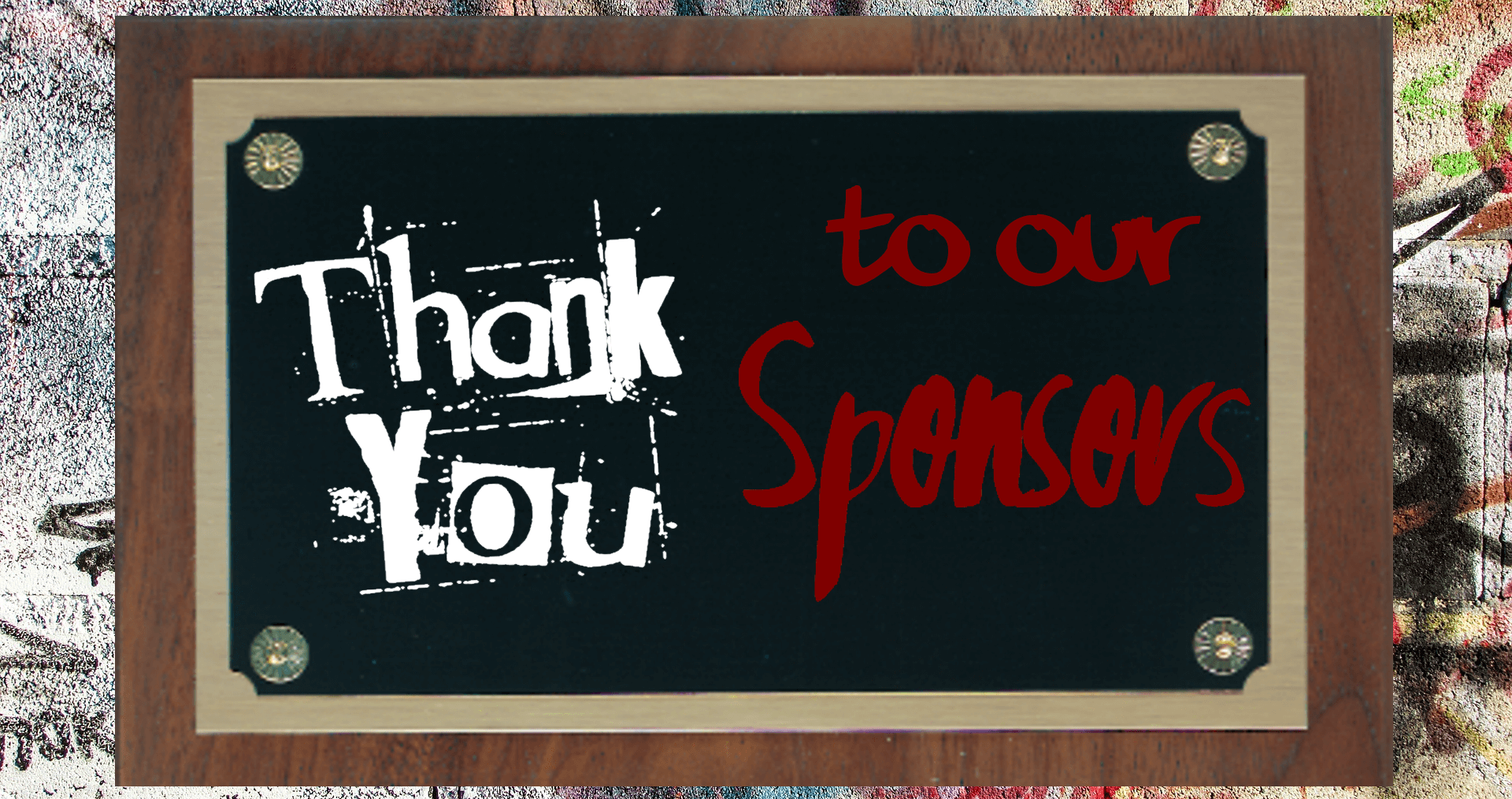 """Sponsors banner for Unwanted Life that is a plaque on a graffiti cover wall and the writing on the plaque says """"Thank you to our sponsors"""""""