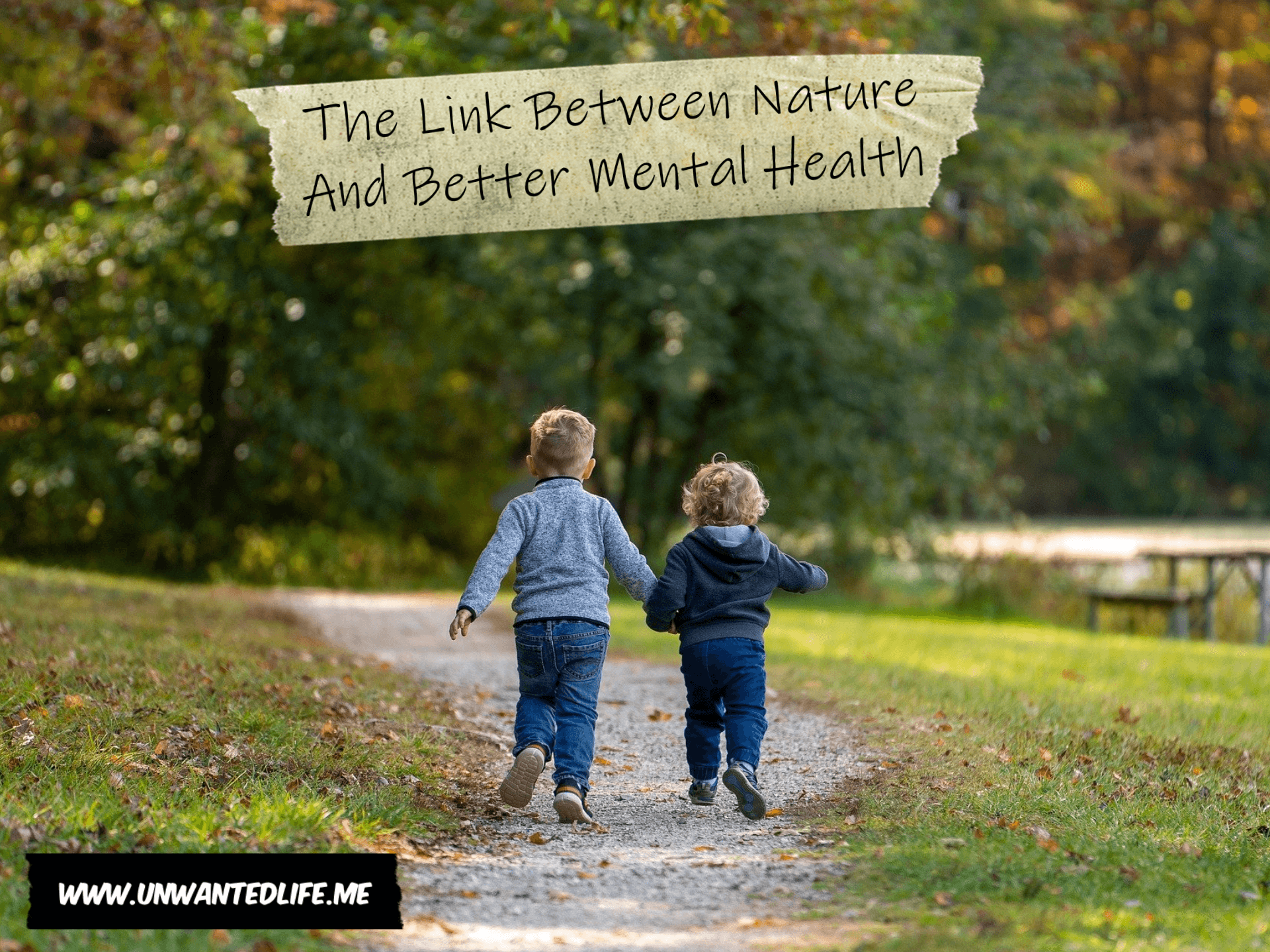 A photo of two children walking along a path in a park to represent the topic of the article - The Link Between Nature And Better Mental Health