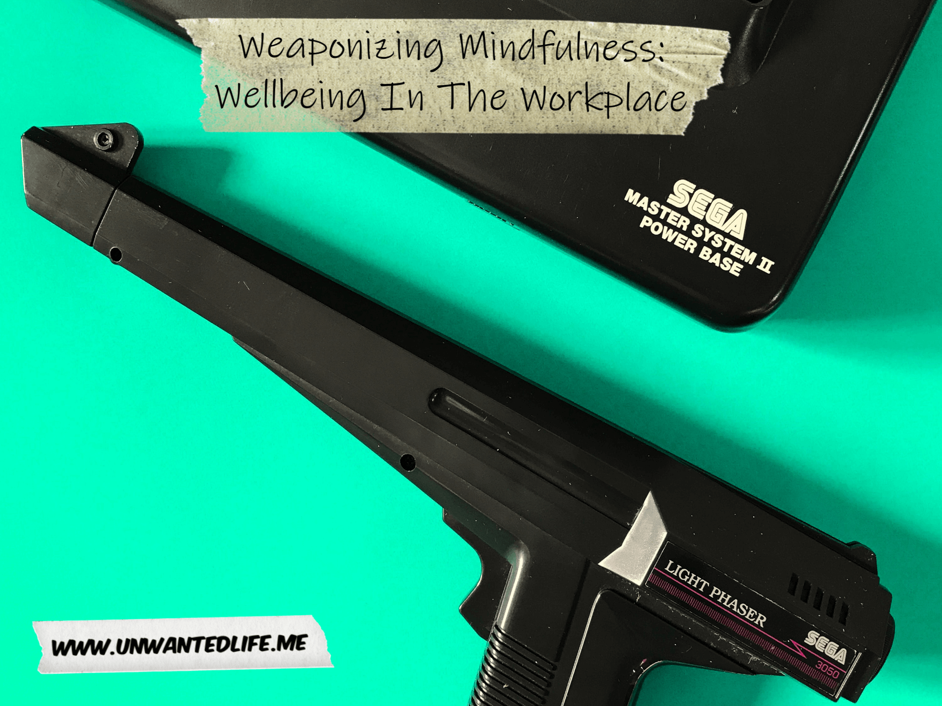 A photo of a Sage Master System 2 and its laser gun to represent the topic of the article - Weaponizing Mindfulness: Wellbeing In The Workplace