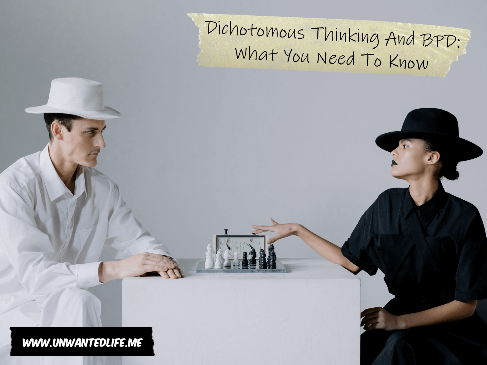 A photo of a woman in all black clothes playing chess with a man in all white clothes to represent the topic of the article - Dichotomous Thinking And BPD What You Need To Know