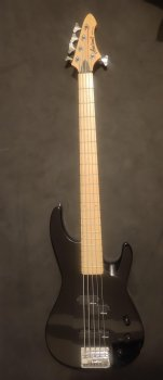 A photo of my old black 5 string bass guitar
