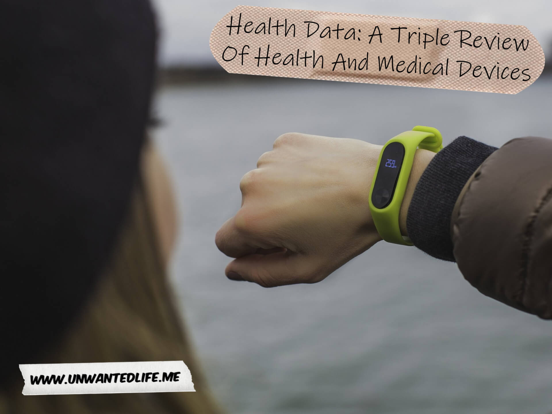 A photo of a white woman wearing a brown puffer jacket and a blag woolly hat, looking at a fitness tracker watch. The image represents the topic of the article - Health Data: A Triple Review Of Health And Medical Devices