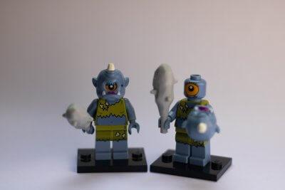 A photo of two Lego trolls